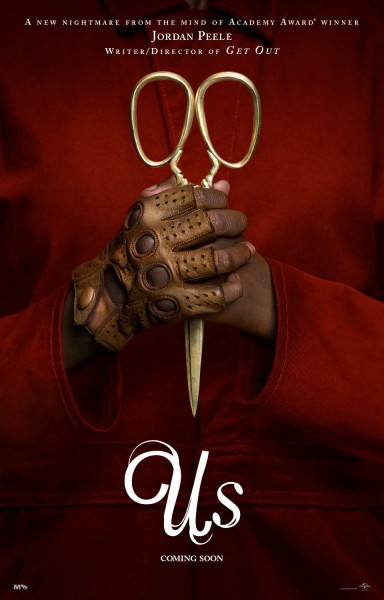 Us movie poster. Hands holding scissors